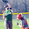 WARREN DILLAWAY / Star Beacon<br /> SAMI GRIFFITH of Lakeside grabs the throw as Kalee Gersin of Geneva arrives safely at second base on Friday at Geneva.