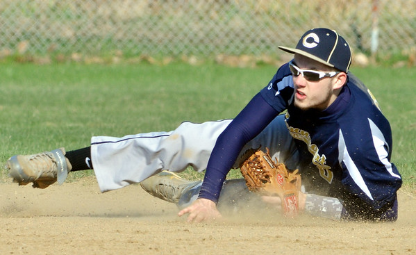 WARREN DILLAWAY / Star Beacon<br /> JOEY BURKE, Conneaut shortstop, makes a diving play on Fridayy afternoonn at Edgewood.