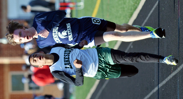 WARREN DILLAWAY / Star Beacon<br /> RAHEEM MORGAN (left) of Lakeside edges Jacob Jarvi of Conneaut during the 1600 meter run at the Falcon Junior High Invitational in Jefferson on Friday evening.