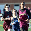 WARREN DILLAWAY / Star Beacon<br /> AUSTIN ROBERTS of Pymatuning Valley (right) leads a group of runners during the 1600 meter run at the Falcon Junior High Invitational in Jefferson on Friday evening.