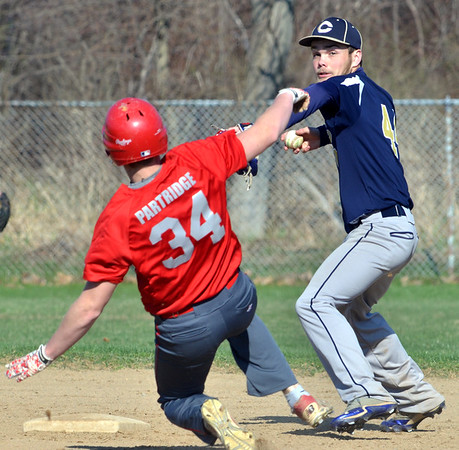 WARREN DILLAWAY / Star Beacon<br /> CLAY FERTIG (right) of Conneaut forces Aaron Patridge of Edgewood at second base on Friday during baseball action at Edgewood.