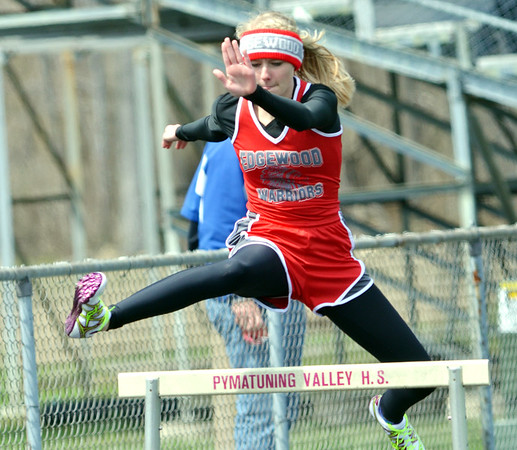 WARREN DILLAWAY / Star Beacon<br /> REBEKAH SIMMOPNS of Edgewood runs the 300 meter hurdles on Saturday during the Pymatuning Valley Invitational in Andover Township.