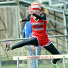 WARREN DILLAWAY / Star Beacon<br /> REBEKAH SIMMOPNS of Edgewood runs the 300 meter hurdles on Saturday during the Pymatuning Valley Invitational in Andover Township.