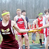 WARREN DILLAWAY / Star Beacon<br /> CORRY MIENTKIEWICZ (left) receives the baton from Pymatuning Valley 4 x 800 meter relay teammate on Tuesday in Andover Township.