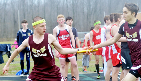 WARREN DILLAWAY / Star Beacon CORRY MIENTKIEWICZ (left) receives the baton from Pymatuning Valley 4 x 800 meter relay teammate on Tuesday in Andover Township.