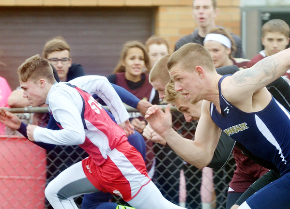 WARREN DILLAWAY / Star Beacon<br /> KENNY CHROMIK (left) of Edgewood gets off to a fast start as Tommy Manning of Conneaut (right) follows closely behind during the 100 meters at a six team track meet at Pymatuning Valley in Andover Township.