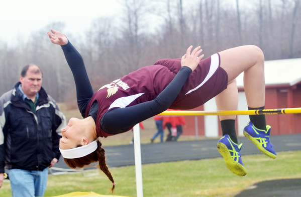 WARREN DILLAWAY / Star Beacon<br /> KAT HALL of Pymatuning Valley high jumps on Tuesday afternoon during a six team track meet at Pymatuning Valley in Andover Township.