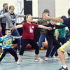 TOM HEINES (far right back to camera) of Empower Sports    leads a defensive drill during a basketball clinic for special needs children on Friday night at Spire Institute.