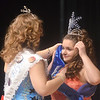 WARREN DILLAWAY / Star Beacon<br /> ELYSE PITKIN (left), outgoing Geneva Miss Winterfest , crowns second attendant Cassandra Burnham on Saturday night at Geneva High School.