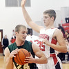 WARREN DILLAWAY / Star Beacon<br /> SAM HITCHCOCK of Jefferson (35) defendsJared Patton of Lakeside on Saturday during a home game with the Dragons.