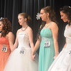WARREN DILLAWAY / Star Beacon<br /> MISS WINTERFEST candidates (from left) Cassandra Burnahm, Bridget Hoffman, Katelyn Salyay and Corrine Stephens wait for the resulst to be announced ddduring the Miss Witnerfest Pageant on Saturday night at Geneva High school.