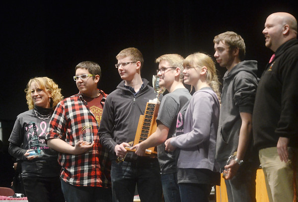 WARREN DILLAWAY / Star Beacon<br /> THE PYMATUNING Valley Scholastic Bowl team (from left) Advisor Annie Siembor, James O'Malley, Chad Lynagh, Stevie Urchek, Jessica Jenick, alternate Dylan Davis and principal Daniel Jackson were all smiles on Monday evening after winning the 28th Annual Ashtabula County Scholastic Bowl at Veterans Memorial Performing Arts Center at Pymatuning Valley High School.
