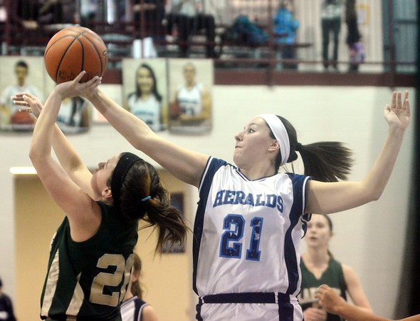WARREN DILLAWAY / Star Beacon<br /> TORI RAY (21) of St. John blocks a shot by Nikki Kelly of Lakeside on Monday evening at Spire Institute.