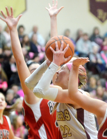 WARREN DILLAWAY / Star Beacon<br /> MEGAN STECH of Pymatuning Valley tries to squeeze between two Badger defenders on Monday evening in Andover Township.