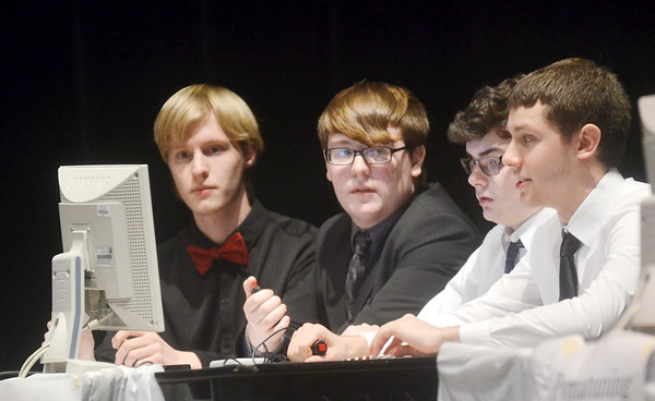 WARREN DILLAWAY / Star Beacon<br /> THE JEFFERSON Scholastic Bowl team (from left) Mark Reinke, Zach Sapatka, Michael Nelson anbd Frank Fioritto  finished third on Monday evening during the 28th Annual Ashtabula County Scholastic Bowl at the Veterans Memorial Performing Arts Center at Pymatuning Valley High School.