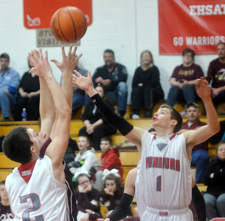 WARREN DILLAWAY / Star Beacon<br /> MITCHELL Dragon (1) and Edgewood teammate Justin Searles (2) of Edgewood reach for the ball on Tuesday night during a home game with Pymatuning Valley.