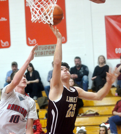 WARREN DILLAWAY / Star Beacon<br /> CHASE THURBER (25) of Pymatuning Valley drives by Marcus Ernst (10) of Edgewood on Tuesdsay night at Edgewood.