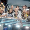 WARREN DILLAWAY / Star Beacon<br /> ST. BONAVENTURE swim fans watch an awards ceremony on Friday night during the Atlantic 10 Swimming Championships at Spire Institute in Harpersfield Township. The event continues this morning.