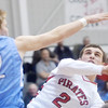 WARREN DILLAWAY / Star Beacon<br /> ANTHONY ZAMPINI of Perry (2) drives to the basket with Parker Gdula of Kenston defending on Friday night at Perry.