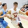 WARREN DILLAWAY / Star Beacon<br /> ZACH BUESCHER (34) of Perry tries to beat a Kenston defender on Friday night at Perry.