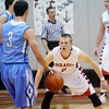 WARREN DILLAWAY / Star Beacon<br /> D.J. AULTMAN (facing) of  Perry defends Jeremy Wyers of Kenston on Friday night at Perry.