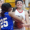 WARREN DILLAWAY / Star Beacon<br /> KALEIGH SLOAN (facing) of Edgewood battles for the ball with Juaneica Casebolt of Collinwood on Thursday night during a Division II sectional championship game against Collinwood at Edgewood.