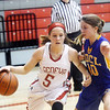 WARREN DILLAWAY / Star Beacon<br /> EMILY HARRIMAN (5) of Geneva drives to the basket as Lexi Hammer of Notre Dame Cathedral Latin defends on Thursday evening during a Division II sectional championship game at Geneva.