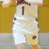WARREN DILLAWAY / Star Beacon<br /> HALEY HOLDEN of Edgewood prepares to pass on Thursday night during a Division II sectional championship game against Collinwood at Edgewood.