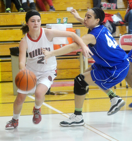 WARREN DILLAWAY / Star Beacon<br /> ASHLEY EVANS (2) of Edgewood drives to the basket as Cayla Napoleon of Collinwood defends on Thursday night during a Division II sectional championship game against Collinwood at Edgewood.