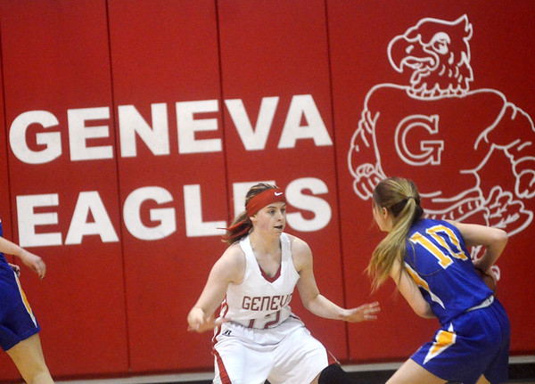 WARREN DILLAWAY / Star Beacon<br /> KRISTIN KEASLING (12) of Geneva defends Lexi Hammer of Notre Dame Cathedral Latin on Thursday evening during a Division II sectional championship game at Geneva.