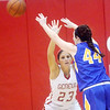 WARREN DILLAWAY / Star Beacon<br /> SARAH JUNCKER (23) of Geneva defends Samantha Flowers of Notre Dame Cathedral Latin on Thursday evening during a Division II sectional championship game at Geneva.
