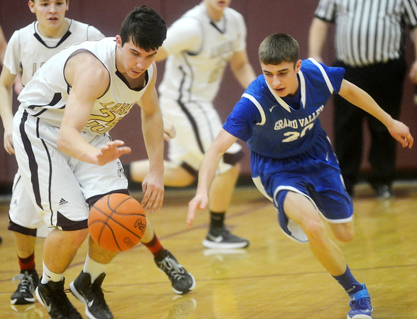 WARREN DILLAWAY / Star Beacon<br /> CHASE THURBER (left) of Pymatuning Valley steals the ball from Noah Glavickas of Grand Valley on Friday in Andover Township.