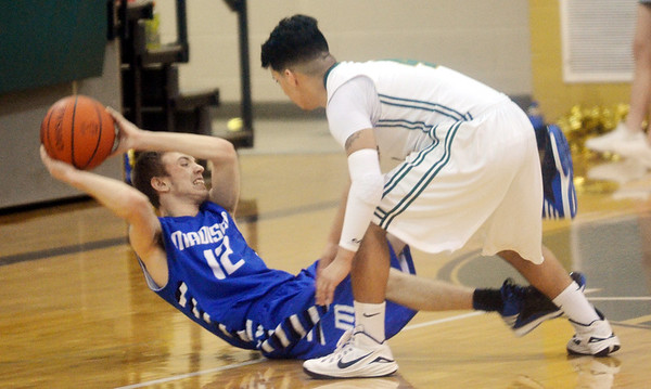 WARREN DILLAWAY / Star Beacon<br /> BRANDON REVLOCK (12) of Madison tries to pass from the court as Mo Lebron of Lakeside defends on Friday at Lakeside.