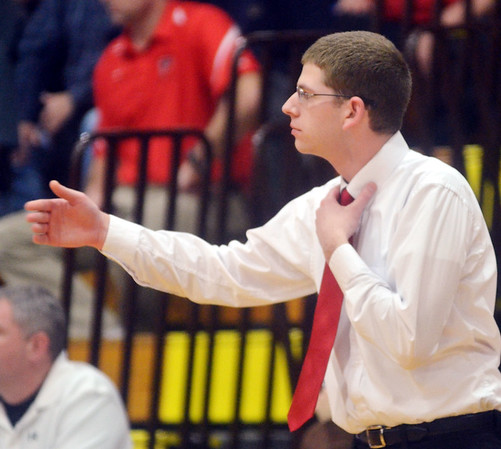 WARREN DILLAWAY / Star Beacon<br /> STEVE FRENCH, Jefferson boys basketball coach, gestures to his team at Edgewood on Tuesday night.
