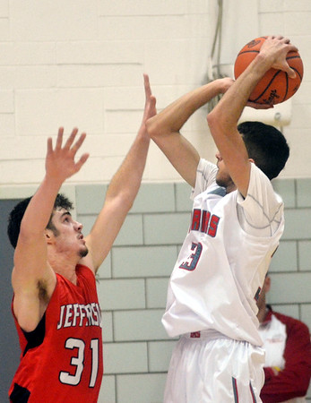 WARREN DILLAWAY / Star Beacon<br /> LUCAS HITCHCOCK (31) of Jefferson defends Eli Kalil of Edgewood on Tuesday night at Edgewood.