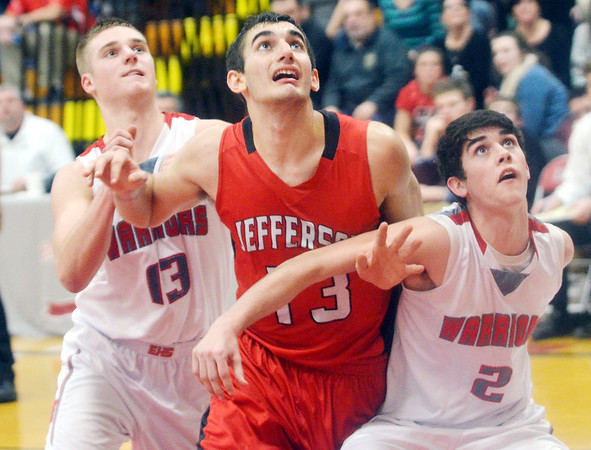 WARREN DILLAWAY / Star Beacon<br /> JACOB ADAMS (13 center) of Jefferson is surrounded by Mason Lilja (left) and Edgewood teammate Justin Searles (2) on Tuesday night at Edgewood.