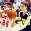 WARREN DILLAWAY / Star Beacon<br /> FELIX RIVERA (24) of Geneva drives to the basket in front of Mattia Bergozza of  Riverside on Friday night at  Geneva.