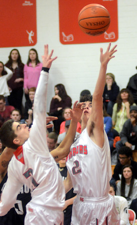 WARREN DILLAWAY / Star Beacon<br /> JUSTIN SEARLES (2) and Edgewood teammate Daniel Joslin (left) reach for the ball on Friday night during a home game with Conneaut.
