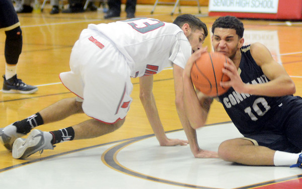 WARREN DILLAWAY / Star Beacon<br /> LEVI STEWART (10) of Conneaut battles for the ball with Mason Lilja of Edgewood on Friday night at Edgewood.