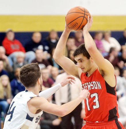 WARREN DILLAWAY / Star Beacon<br /> JACOB ADAMS (13) of Jefferson prepares to make a move on Saturday night while defended by Alex Gerdes of Conneaut at Garcia Gymnasium.