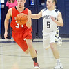 WARREN DILLAWAY / Star Beacon<br /> TROY COLUCCI (5) of Conneaut  chases Lucas Hitchcock of Jefferson up the court on Saturday night at Garcia Gymnasium.