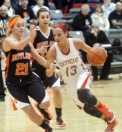 WARREN DILLAWAY / Star Beacon<br /> LINDSEY MAYLE (13) of Geneva drives by Alexis Ross (21) of Howland on Saturday at Geneva.