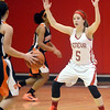 WARREN DILLAWAY / Star Beacon<br /> EMILY HARRIMAN of Geneva defends a Howland ball handler on Saturday afternoon at Geneva.