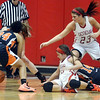 WARREN DILLAWAY / Star Beacon<br /> SARAH JUNCKER (23) of Geneva and teammate Courtney Harriman (center on ground) react to the ball as Howland players Jada Pagan (24) and Trisha Ginnis (14) respond on Saturday at Geneva.