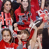WARREN DILLAWAY / Star Beacon<br /> ELEMENTARY STUDENTS at St. John School  iin Saybrook Township display Ohio signs on Monday during a pep rally in honor of Ohio State football coach Urban Meyer who graduated from the school in 1982. Oho State played Oregon in the national championship game on Monday night in Arlington, TX.