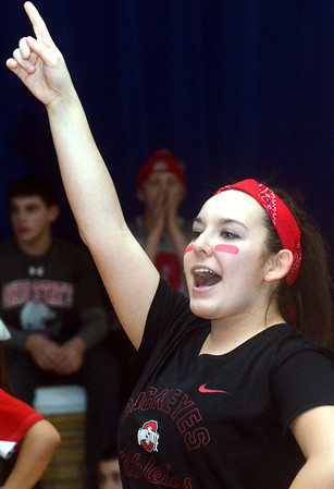 WARREN DILLAWAY / Star Beacon<br /> JORDAN SCOTT, a varsity cheerleader at St. John High School, gets students fired up on Monday during a pep rally in honor of Ohio State football coach Urban Meyer who graduated from the school in 1982. Oho State played Oregon in the national championship game on Monday night in Arlington, TX.