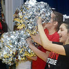 WARREN DILLAWAY / Star Beacon<br /> FRANCHESCA VENTURA, an eighth grade cheerleader at St. John  School, get students fired up on Monday during a pep rally in honor of Ohio State football coach Urban Meyer who graduated from the school in 1982. Ohio State played Oregon in the national championship game on Monday night in Arlington, TX.