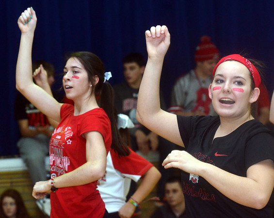 WARREN DILLAWAY / Star Beacon<br /> MALLORY SHELLENBERGER and Jordan Scott, varsity cheerleaders at St. John High School, get students fired up on Monday during a pep rally in honor of Ohio State football coach Urban Meyer who graduated from the school in 1982. Ohio State played Oregon in the national championship game on Monday night in Arlington, TX.
