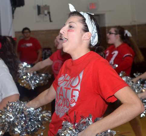 WARREN DILLAWAY / Star Beacon<br /> REILLY DECATO, a varsity cheerleader at St. John High School, get students fired up on Monday during a pep rally in honor of Ohio State football coach Urban Meyer who graduated from the school in 1982. Ohio State played Oregon in the national championship game on Monday night in Arlington, TX.