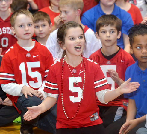 WARREN DILLAWAY / Star Beacon<br /> TESS COLLINS (5) gets fired up on Monday during a pep rally in honor of Ohio State football coach Urban Meyer who graduated from the school in 1982. Ohio State played Oregon in the national championship game on Monday night in Arlington, TX.